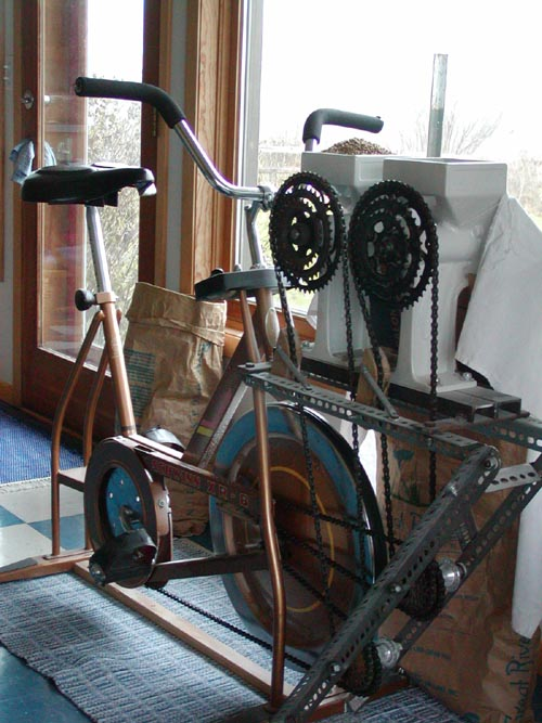 Converted her exercycle so that it would grind two Country Living Mills simultaneously!