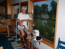 Pedal power on a chain-driven grain mill