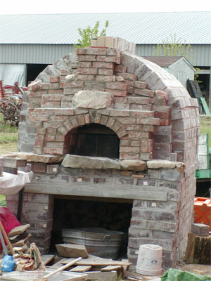 I love when I have done several bakes in my outdoor brick oven and I have all that bread cooling and it smells so good